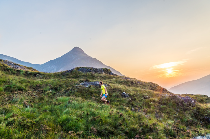 Trailrunner during sunset in the Scottish Highlands at Loch Leven, Great Brittain